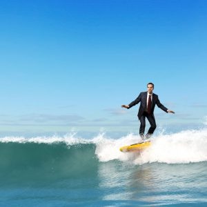 Surfboarding businessman | Mcquaig